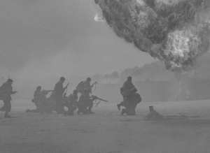black and white photo of troops going to war with explosion in background
