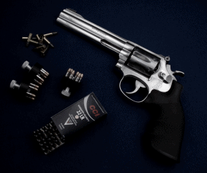 smith & wesson 617 revolver 22 lr on blue table