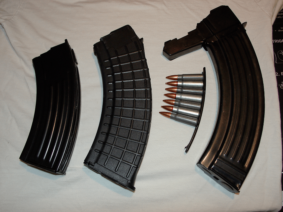From left to right: Mini-30 magazine [20 round], AK-47 magazine [30 round], SKS stripper clip [10 round] with alternating Wolf and Silver Bear ammunition, and SKS detachable magazine [30 round].