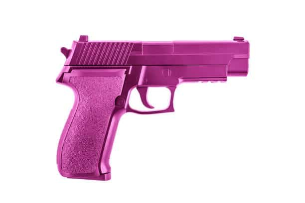 Pink pistol gun isolated on white background with clipping path